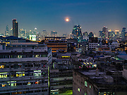 23 MARCH 2016 - BANGKOK, THAILAND: The full moon over the Talat Noi section of Bangkok's Chinatown.      PHOTO BY JACK KURTZ