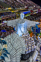 "A float featuring Rio's Christ the Redeemer statue. Carnaval parade of Unidos da Tijuca samba school in the Sambadrome, Rio de Janeiro, Brazil.        <br /> <br /> The theme of this parade is ""Where Dreams Live"" and tells the history of architecture and urbanism. Sambadrome, Rio de Janeiro, Brazil. The Christ statue is animatronic. It moves forward and back, opening and closing its arms."