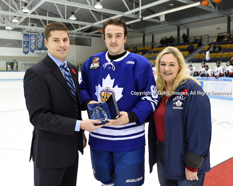 MARKHAM, ON - Nov 6, 2015 : Ontario Junior Hockey League game action between Pickering and Markham, Tyson Bruce #89 of the Markham Royals receives player of the month award from OJHL Manager, Hockey Operations Brent Garbutt and Jodi Lanzarotta Markham Royals Executive Assistant to the Governor.<br /> (Photo by Andy Corneau / OJHL Images)