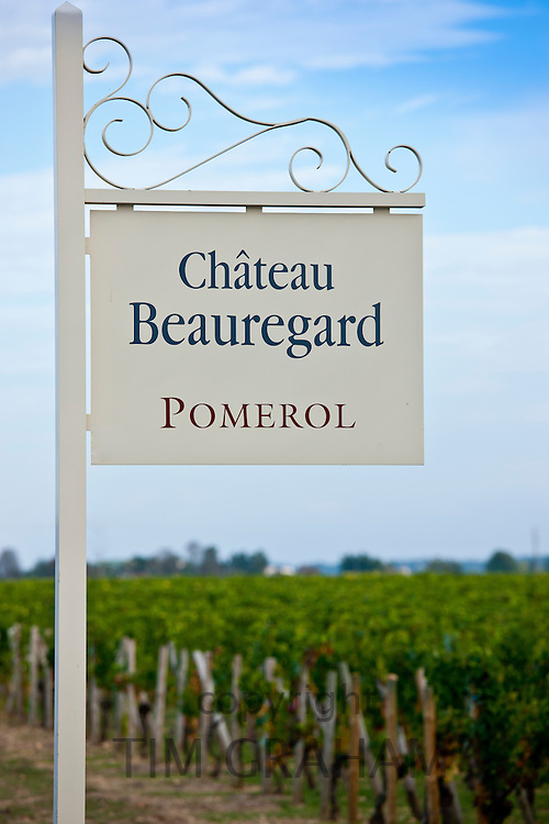 Sign for Chateau Beauregard wine estate above vines at Pomerol in the Bordeaux region of France
