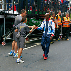 © Licensed to London News Pictures.  10/09/2012. LONDON, UK. Mo Farah (pictured right) shakes hands during the Olympic and Paralympic Parade of athletes through central London. Photo credit :  Cliff Hide/LNP