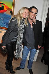 JENNY HALPERN and her husband RYAN PRINCE at a reception to celebrate the publication of Candy and Candy: The Art of Design held at the Halcyon Gallery, 24 Bruton Street, London W1 on 26th October 2011.