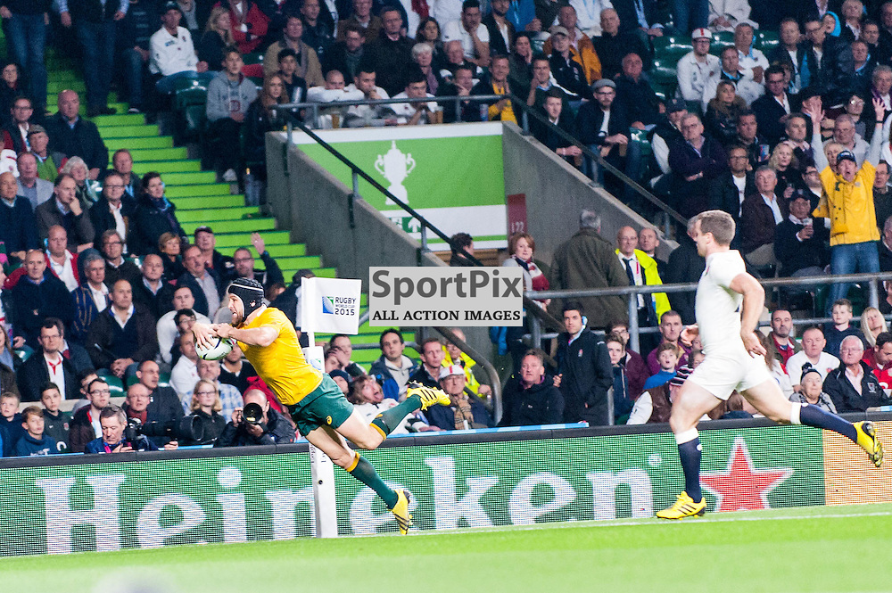 Matt Giteau of Australia dives in for the winning try. Action from the England v Australia game in Pool A of the 2015 Rugby World Cup at Twickenham in London, 3 October 2015. (c) Paul J Roberts / Sportpix.org.uk