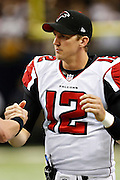 NEW ORLEANS, LA - NOVEMBER 11:  Luke McCown #12 of the Atlanta Falcons warms up before a game against the New Orleans Saints at Mercedes-Benz Superdome on November 11, 2012 in New Orleans, Louisiana.  The Saints defeated the Falcons 31-27.  (Photo by Wesley Hitt/Getty Images) *** Local Caption *** Luke McCown