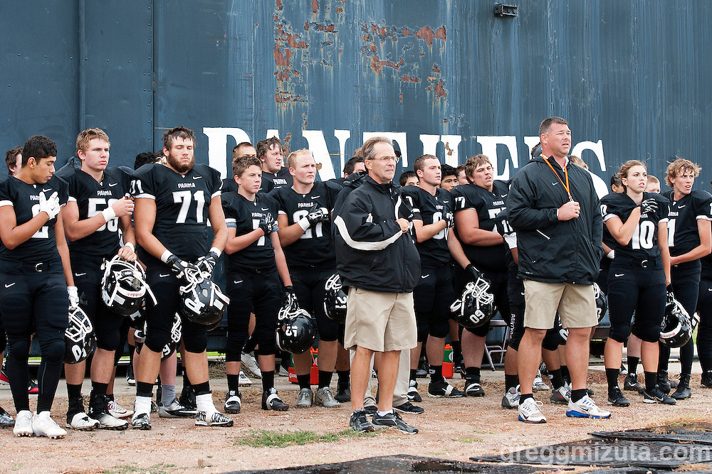 Parma football during the National Anthem before the stat of the Vale - Parma football game, September 4, 2015 at Parma High School, Parma, Idaho. Vale won 31-10.