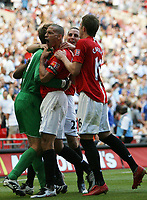 Photo: Rich Eaton.<br /> <br /> Manchester United v Chelsea. FA Community Shield. 05/08/2007. Manchester United players celebrate victory over Chelsea on penalties by mobbing Edwin Van der Sar.