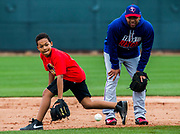 Texas Rangers shortstop Elvis Andrus (1) coaches Adrian (A.J.) Beltre, Jr., son of third baseman Adrian Beltre (29), as he fields a grounder during a spring training workout at the team's training facility on Sunday, February 19, 2017 in Surprise, Arizona. (Ashley Landis/The Dallas Morning News)