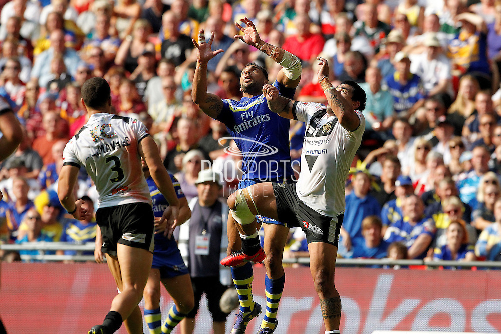 Ryan Atkins and Hull's Mahe Fonua go for the high ball during the Challenge Cup Final 2016 match between Warrington Wolves and Hull FC at Wembley Stadium, London, England on 27 August 2016. Photo by Craig Galloway.