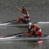 Tim Ole Naske (back) of Germany and Dan de Groot of Canada reacts at the end of the race in rowing Junior Men's Pair Final A at Xuan Wu Lake in Nanjing Youth  Olympic Games  2014 in Nanjing, China, 20 August 2014. The Nanjing Youth Olympic Games 2014 runs from from 16 to 28 August  2014.