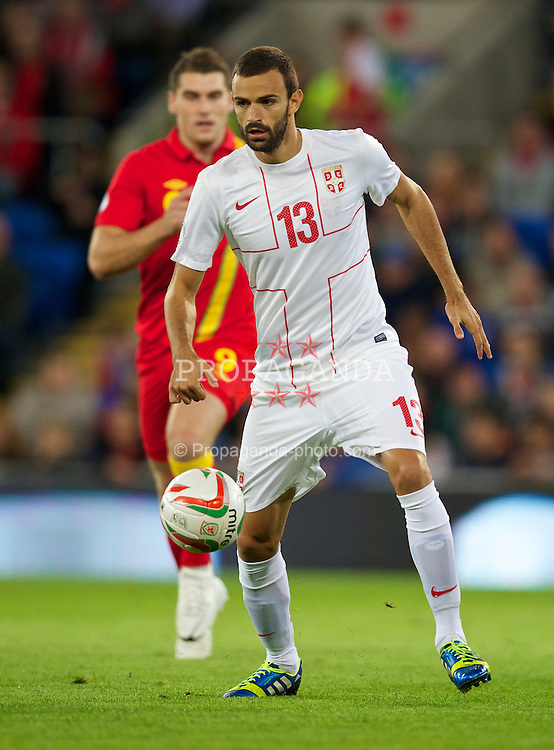 CARDIFF, WALES - Tuesday, September 10, 2013: Serbia's Ivan Radovanovic in action against Wales during the 2014 FIFA World Cup Brazil Qualifying Group A match at the Cardiff CIty Stadium. (Pic by David Rawcliffe/Propaganda)