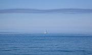 Clouds look like wings over sailboat in the Atlantic Ocean; Vacation trip to Monhegan Island