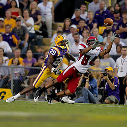 19 September 2009: Louisiana-Lafayette Cajuns wide receiver Louis Lee (84) reaches for the ball as LSU Tigers cornerback Chris Hawkins (29) covers the play during a 31-3 win by the LSU Tigers over the University of Louisiana-Lafayette Ragin Cajuns at Tiger Stadium in Baton Rouge, Louisiana.