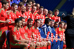CARDIFF, WALES - Wednesday, June 3, 2015: Wales Joe Ledley and Gareth Bale hold up Show Racism The Red Card posters during a photo shoot at the Cardiff City Stadium ahead of the UEFA Euro 2016 Qualifying Round Group B match against Belgium. (Pic by Mark Hawkins/Propaganda)