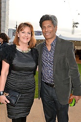 DES GUNEWARDENA Chairman / Ceo Of D&D London and his wife LIZ GUNEWARDENA at the Battersea Power Station Annual Party at Battersea Power Station, 188 Kirtling Street, London SW8 on 30th April 2014.