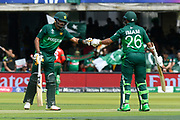Babar Azam of Pakistan and Imam-ul-Haq of Pakistan touch gloves after a boundary brought up the teams 150 during the ICC Cricket World Cup 2019 match between Pakistan and Bangladesh at Lord's Cricket Ground, St John's Wood, United Kingdom on 5 July 2019.