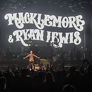 "WASHINGTON, DC - November 18, 2013 - Macklemore and Ryan Lewis  perform at the Verizon Center in Washington, D.C. The duo is still riding high off of their 2012 album, The Heist, which contains the #1 singles ""Thrift Shop"" and ""Can't Hold Us."" (Photo by Kyle Gustafson / For The Washington Post)"