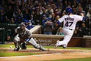 April 17, 2017 - Chicago, IL, USA - Chicago Cubs catcher Miguel Montero (47) scores on an RBI double by Chicago Cubs center fielder Albert Almora Jr. (5) during the second inning against the Milwaukee Brewers on Monday, April 17, 2017 at Wrigley Field in Chicago, Ill. (Credit Image: © Nuccio Dinuzzo/TNS via ZUMA Wire)