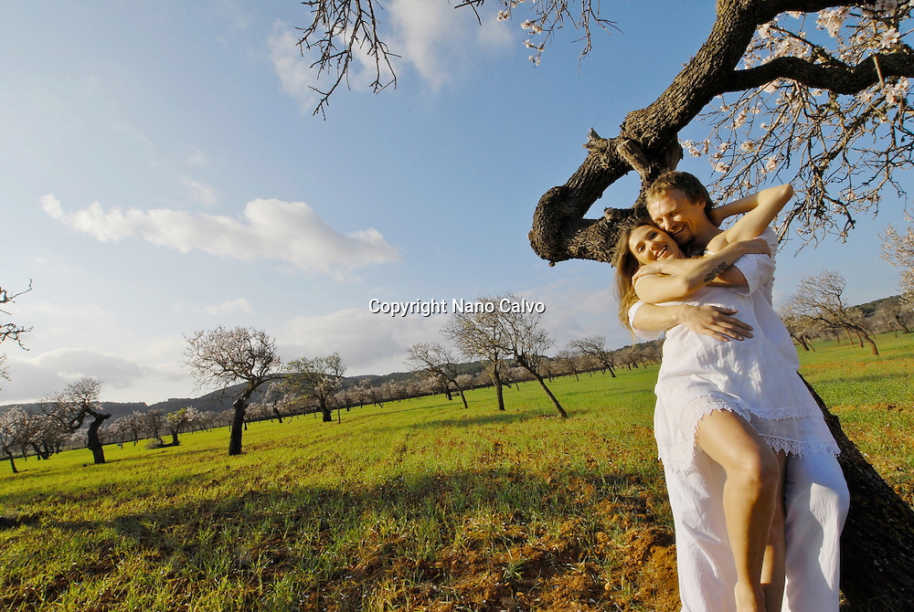 Portrait of a couple formed of a brazilian woman and a sweedish man, loving each other outdoors, in Ibiza, Spain.