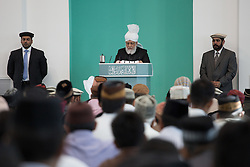 Image ©Licensed to i-Images Picture Agency. 27/06/2014. Morden, United Kingdom. British Muslims condemn Isis at Friday prayers in LND Mosque. Fifth Caliph and worldwide head of the Ahmadiyya Muslim Community, Mirza Masroor Ahmad preach in front of hundreds of Ahmadiyya Muslim worshippers at the Baitul Futuh mosque in Morden - the largest mosque in western Europe as he previously denounced Isis and extremism. Baitul Futuh Mosque. Picture by Daniel Leal-Olivas / i-Images