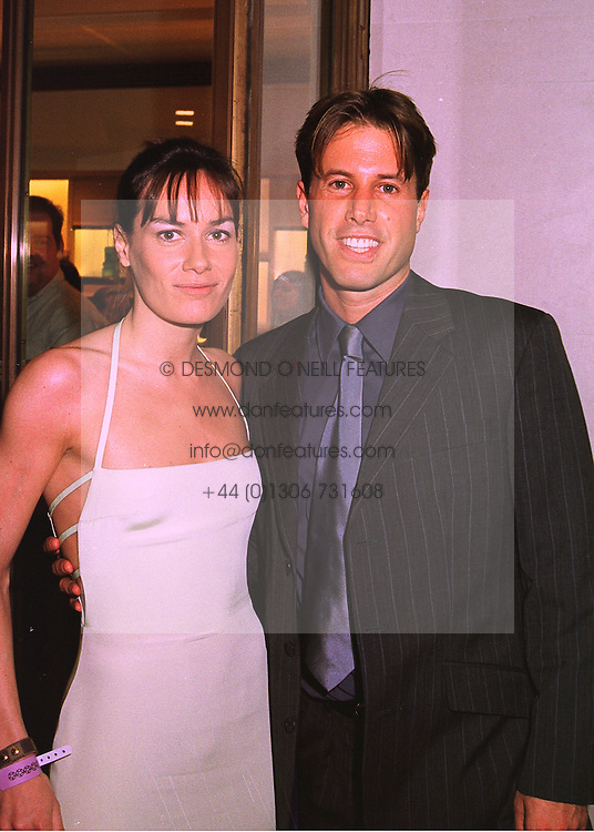 MISS TARA PALMER-TOMKINSON and MR JOE SIMON at a party in London on 24th February 1998.MFP 52