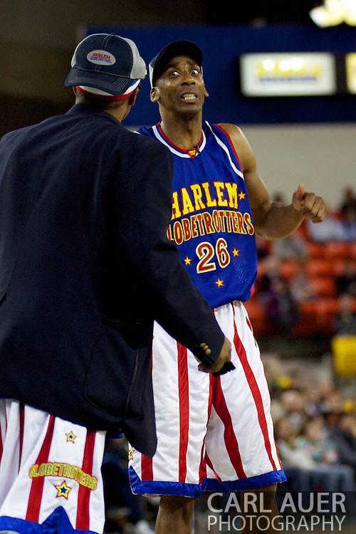 April 30th, 2010 - Anchorage, Alaska:  Harlem Globetrotter Hi-Lite Bruton (26) argues with Umpire Dizzy Grant Friday night at the Sullivan Arena.