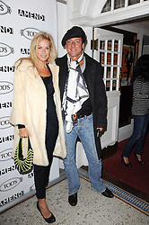 EMMA WOOLLARD and JEREMY HEALEY at an In-House screening of 'Sweet Smell of Success' hosted by Clive Owen presented by Tod's in association with Amend held at The Electric Cinema, 191 Portobello Road, London W11 on 29th November 2010.