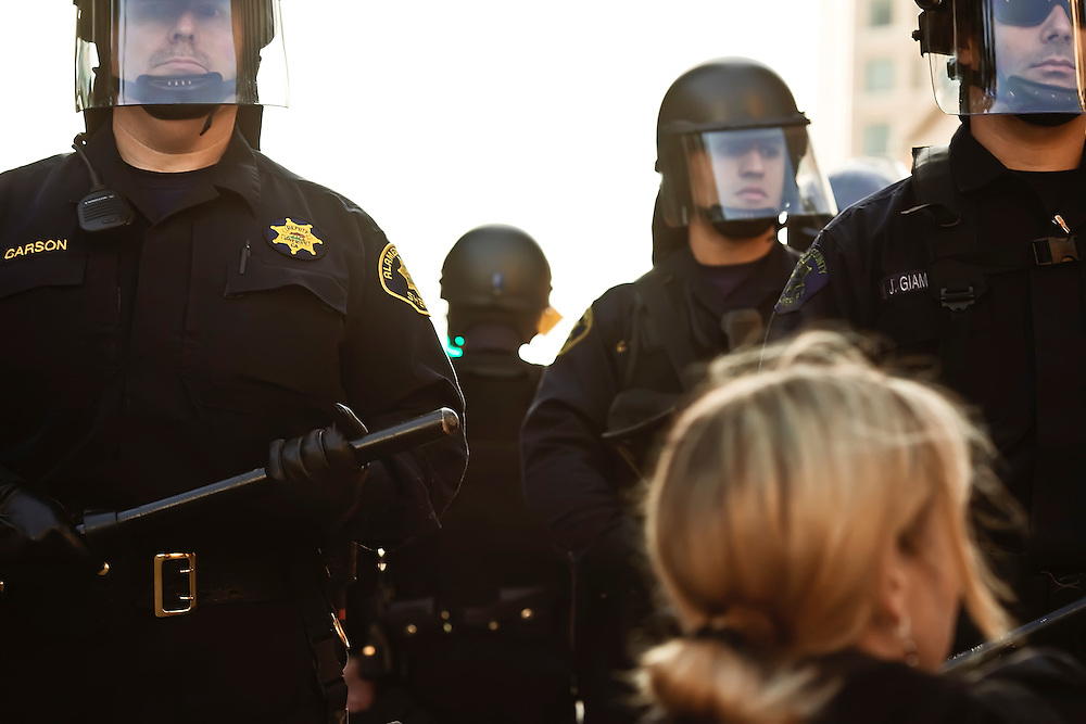 Police confront protesters at Oscar Grant demonstration in Oakland, CA. Copyright 2010 Reid McNally.