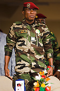 "Guinea president Captain Moussa Dadis Camara stands up for the national anthem during an official visit at the Kofi Annan private university in Conakry, Guinea on Thursday March 5, 2009. Camara, who took power after a coup in December 2008, was visiting the university to ""meet the youth"", as part of his efforts to solidify his support from Guinea's population.(Olivier Asselin for the New York Times)"