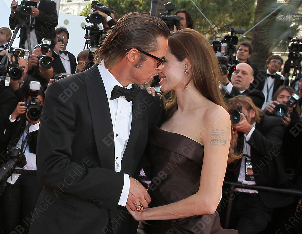 16.MAY.2011. CANNES<br /> <br /> BRAD PITT AND ANGELINA JOLIE AT THE PREMIERE OF TREE OF LIFE AT THE 64TH CANNES INTERNATIONAL FILM FESTIVAL 2011 IN CANNES, FRANCE<br /> <br /> BYLINE: EDBIMAGEARCHIVE.COM<br /> <br /> *THIS IMAGE IS STRICTLY FOR UK NEWSPAPERS AND MAGAZINES ONLY*<br /> *FOR WORLD WIDE SALES AND WEB USE PLEASE CONTACT EDBIMAGEARCHIVE - 0208 954 5968*