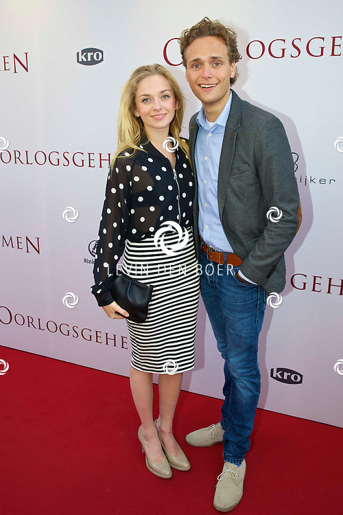 AMSTERDAM - In het Tuschinski Theater ging de nieuwe Nederlandse film 'Oorlogsgeheimen' in premiere. Met hier op de foto  Pip Pellens met haar partner Pim Wessels. FOTO LEVIN DEN BOER - PERSFOTO.NU