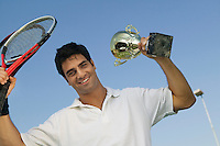Tennis Player Holding Trophy