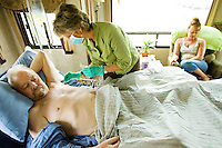 "April 30 -- Dick Warner stays stoic as his then-girlfriend, Nancy Williams, lets Joni Connelly checks the ""central line"" that flows morphine into his body. There were very few procedures that were out of Nancy's reach which didn't allow without her direct participation."