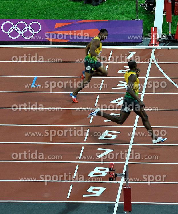 Olympics - London 2012 Olympic Games - 9/8/12.Athletics - Men's 200m - Final - Jamaica's Usain Bolt celebrates winning gold, Yohan Blake (JAM, L).© pixathlon