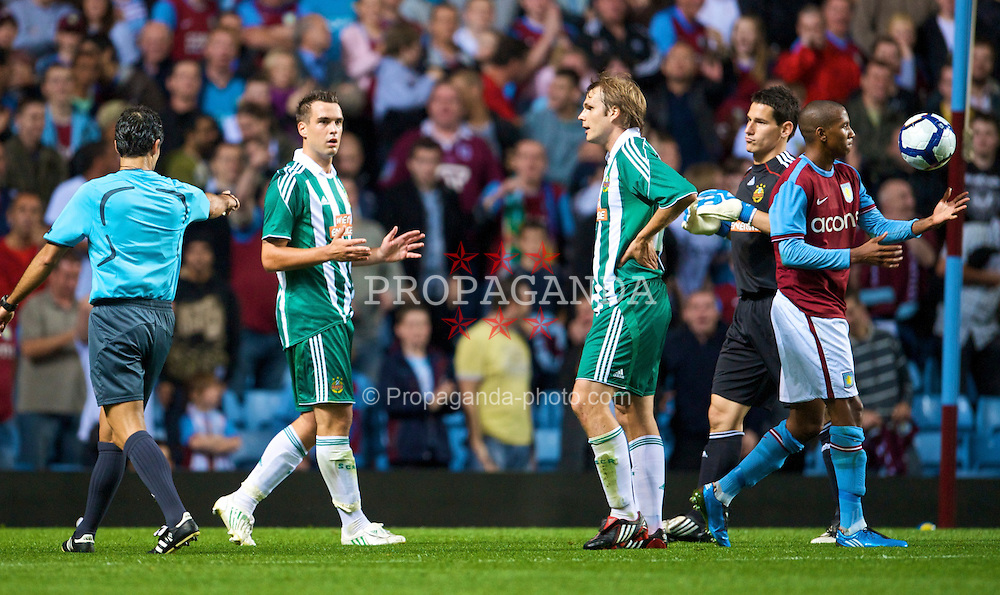 BIRMINGHAM, ENGLAND - Thursday, August 27, 2009: SK Rapid Vienna's Andreas Dober looks dejected as referee Carlos Velasco Carballo points to the spot to award Aston Villa as second penalty during the UEFA Europa League Play-Off 2nd Leg match at Villa Park. (Photo by David Rawcliffe/Propaganda)
