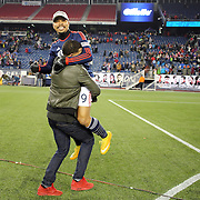 Charlie Davies, New England Revolution, is embraced after his two goals secured an aggregate victory for his side during the New England Revolution Vs New York Red Bulls, MLS Eastern Conference Final, second leg. Gillette Stadium, Foxborough, Massachusetts, USA. 29th November 2014. Photo Tim Clayton