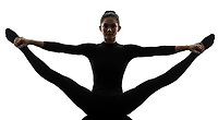 one  woman practicing gymnastic yoga stretching split in silhouette on white background