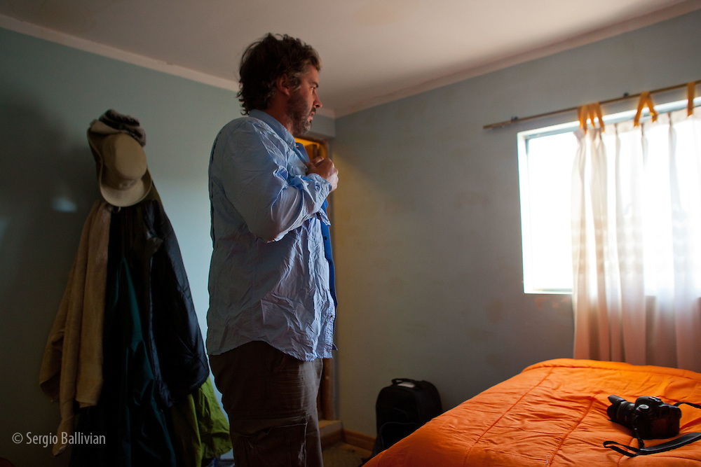 Corey begins the day with a clean but crumpled shirt in the village of Jirira, Potosi, Bolivia.