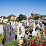 Catholic church cemetery with the Protestant Evangelical church in background, Appenzell, Switzerland<br />