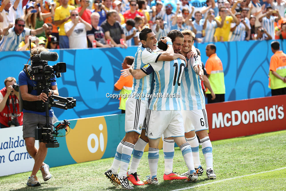 Fifa Soccer World Cup - Brazil 2014 - <br /> ARGENTINA (ARG) Vs. BELGIUM (BEL) - Quarter-finals - Estadio Nacional Brasilia -- Brazil (BRA) - 05 July 2014 <br /> Here Argentine players Angel Di Maria (L), Lionel Messi (C), Gonzalo Higuain (C) and Lucas Biglia (R) celebrating Higuain's goal. Scoring the match 1-0.<br /> &copy; PikoPress