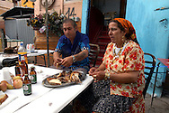 Rome  May 6 2007.Rom's camp Casilino 900.Lunch of a family Bosnian Roma
