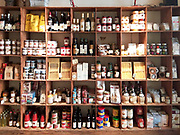 Groceries on shelves in an Italian food store.