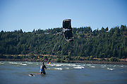 Alfonso Jiminez, a Mexican national, walks into the Columbia River  as he prepares for his first day of kiteboarding at Hood River.