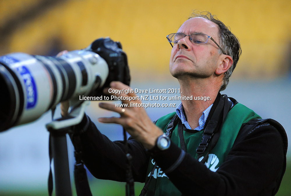 DomPost photographer Ross Giblin checks his images during the A-League football match between Wellington Phoenix v Newcastle Jets at Westpac Stadium, Wellington, New Zealand on Friday, 23 December 2011. Photo: Dave Lintott / lintottphoto.co.nz