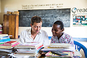 VSO volunteer Paul Jennings prepares for a training session with local teacher Rebecca  Ngovano. Paul has been working with Rebecca for over 6 months to improve teaching methodologies in classrooms. Angaza school, Lindi, Tanzania