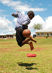 Lawrence Mafumu a pupil of the Jack's Standard primary school shows his skills with the ball during break time in the school compound, Oct 22 2009 . The pupils at the school play football on a daily basis with dreams of making it to the top and also  emulate the proprietor of the school, Jackson Mayanja who has built the school from his earnings from football.