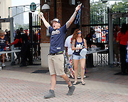 ATLANTA, GA - OCTOBER 2:  A fan walks into Turner Field as the gates open for the last time before the game between the Detroit Tigers and the Atlanta Braves on Sunday, October 2, 2016 in Atlanta, Georgia. (Photo by Mike Zarrilli/MLB Photos via Getty Images) *** Local Caption ***