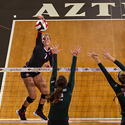 27 August 2016: The San Diego State Aztecs took on the Michigan State Spartans in game two of the Aztec Invitational at Peterson Gym on the campus of SDSU. OH Hannah Turnlund (7) attempts to spike the ball in the first set against the Spartan defense. The Aztecs lost 3-1 to the Spartans. www.sdsuaztecphotos.com
