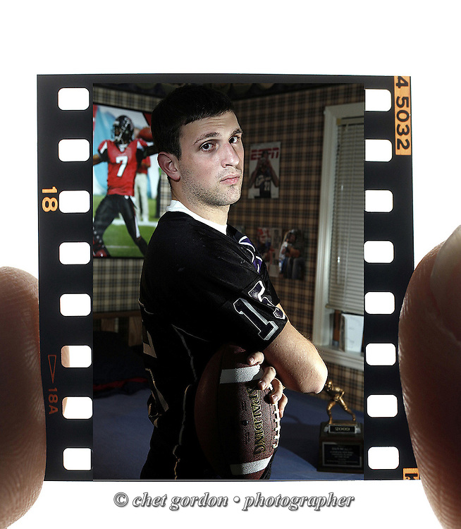 Monroe-Woodbury QB Dan Scalo is the Times Herald-Record's 2009 Varsity Football Player of the Year. He's seen photographed in his bedroom of their Chester, NY home on Tuesday, December 8, 2009.