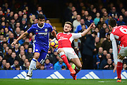 Chelsea forward Diego Costa (19) in action with Arsenal defender Shkodran Mustafi (20) during the Premier League match between Chelsea and Arsenal at Stamford Bridge, London, England on 4 February 2017. Photo by Jon Bromley.