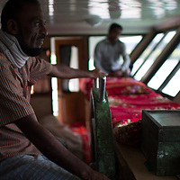 The driver steers the river launch towards the Bay of Bengal along one of Bangladesh's 20,000 kilometers of waterways. These launches or ferries are an important part of Bangladesh's transport infrastructure